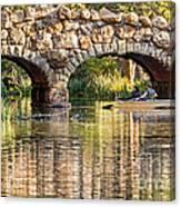 Boaters Under The Bridge Canvas Print