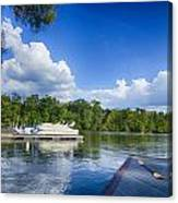Boats At Dock On A Lake With Blue Sky Canvas Print