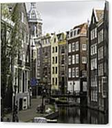 Boats In Canal Amsterdam Canvas Print