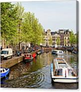 Boats On Canal Tour In Amsterdam Canvas Print