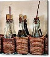 Bottles In Baskets Canvas Print