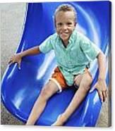 Boy On Slide Canvas Print