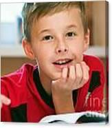 Boy Reading Book Portrait Canvas Print