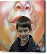 Boy With His Portrait Canvas Print