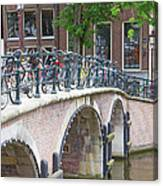Bridge Over Canal With Bicycles  In Amsterdam Canvas Print