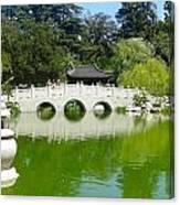 Bridge Over Emerald Water Canvas Print