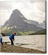 Brother And Sister Playing Near A Lake Canvas Print