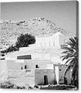 buildings and palm trees overground on the surface at Matmata Tunisia Canvas Print