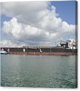 Bulk Cargo Ship With Tug Escort Canvas Print
