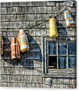 Buoys On A Wall At Peggys Cove Canvas Print