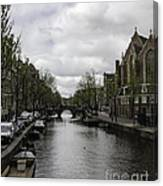 Canal Behind Oude Kerk In Amsterdam Canvas Print