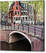 Canal Bridge And Houses In Amsterdam Canvas Print