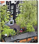 Canal Houses And Houseboat In Amsterdam Canvas Print