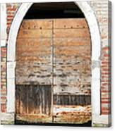 Canalside Weathered Door Venice Italy Canvas Print