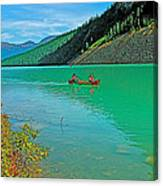 Canoe On Lake Louise In Banff Np-alberta Canvas Print