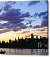 Canoeing At Sunset Canvas Print