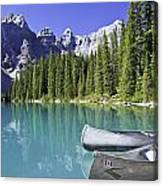 Canoes In Moraine Lake And Valley Of Canvas Print