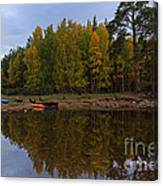 Canoes On The Shore At Loch An Eilein Canvas Print