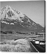 cars in the evening on the road towards Errigal mountain donegals highest peak against a blue sky between dunlewey and gweedore white quartzite conical cone county Donegal Republic of Ireland Canvas Print