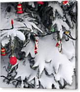 Christmas Decorations On Snowy Tree Canvas Print