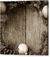 Christmas Wreath With Ornaments And Pine Cones On Rustic Wood Ba Canvas Print