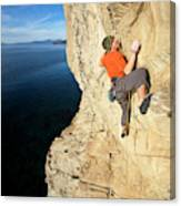 Climber Reaches For Hand Hold Canvas Print