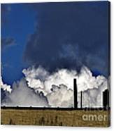 Clouds Over The Watertower Canvas Print