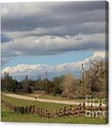Cloudy Sky With A Log Fence Canvas Print