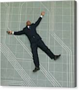 Conceptual Shot Of An African American Business Man As He Lays Flat On The Ground Holding His Phone Canvas Print