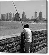 Contemplative Fisherman In Tel Aviv Canvas Print