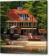 Cottage On A Lake Canvas Print