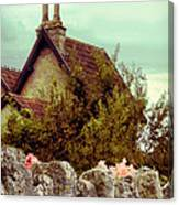 Cottage Seen Over A Wall Canvas Print
