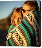 Couple Wraps Themselves In A Blue Canvas Print
