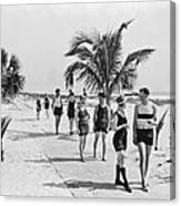 Couples Strolling Along The Pathway On The Beach. Canvas Print
