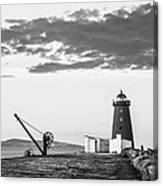 Davit And Lighthouse On A Breakwater Canvas Print