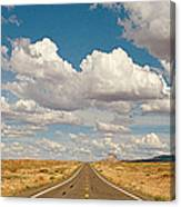 Desert Road With Cloud Formations Above Canvas Print