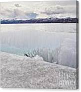 Disintegrating Candelized Melting Ice On Lake Shore Canvas Print