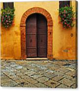 Door And Flowers In A Tuscan Courtyard Canvas Print