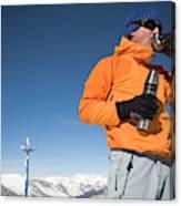 Dressed In Orange, A Skier Sips A Warm Canvas Print