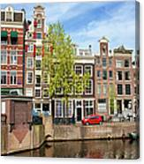Dutch Canal Houses In Amsterdam Canvas Print