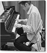 Elvis Presley on piano while waiting for a show to start 1956 Canvas Print