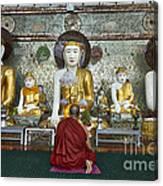 faithful Buddhist monk praying at Buddha Statues in SHWEDAGON PAGODA Canvas Print