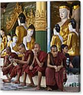 faithful Buddhist monks siiting around Buddha Statues in SHWEDAGON PAGODA Canvas Print