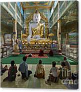 faithful Buddhists praying at sitting Buddha in golden Ponnya Shin Pagoda Canvas Print