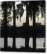 Family Silhouetted By Lake Canvas Print