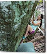 Female Athlete Climbing On Boulder Canvas Print
