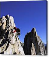 Female Climber Reaching The Top Canvas Print