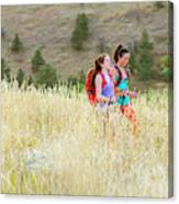 Female Hikers Walk On A Trail Canvas Print