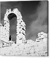 Female Tourist Walks Up The Stepped Seating Area Towards Ruined Archways Of The Old Roman Colloseum At El Jem Tunisia Canvas Print