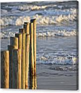 Fence Posts Into The Sea Canvas Print